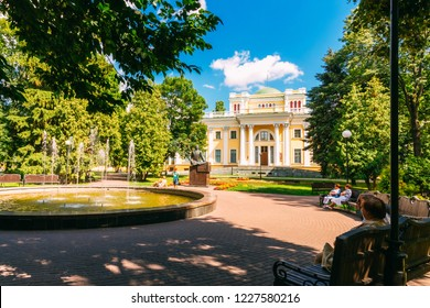 Gomel, Belarus - June 8, 2018: Summer park in the city of Gomel with people on the bench at the Palace of Rumyantsev Paskevich