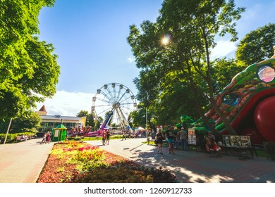 Gomel, Belarus - June 8, 2018: Amusement park and entertainment with a view of the Ferris wheel on a bright summer day in the city of Gomel