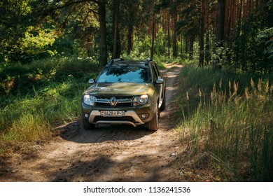 Gomel, Belarus - Junly 5, 2018: Dirty Car Renault Duster SUV in summer coniferous forest. Duster produced jointly by French manufacturer Renault and its Romanian subsidiary Dacia.