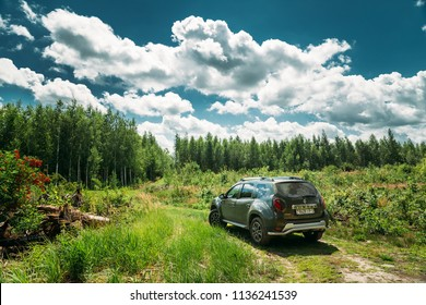 Gomel, Belarus - Junly 5, 2018: Car Renault Duster SUV in summer forest landscape. Duster produced jointly by French manufacturer Renault and its Romanian subsidiary Dacia.