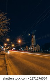 Gomel, Belarus - March 23, 2017: Night street Soviet with traffic in Gomel with a church near it