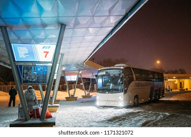 Gomel, Belarus - March 4, 2018: Bus parking at Gomel bus station on a winter evening