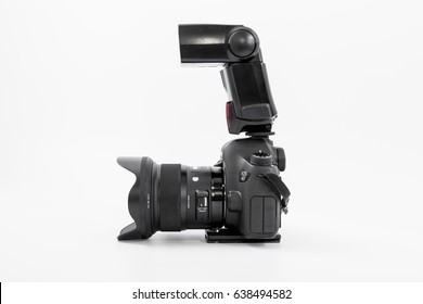 GOMEL, BELARUS - May 12, 2017: Canon 6d camera with lens on a white background. Canon is the world's largest SLR camera manufacturer