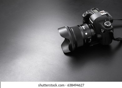 GOMEL, BELARUS - May 12, 2017: Canon 6d camera with lens on a black background. Canon is the world's largest SLR camera manufacturer