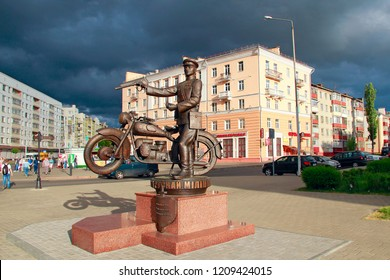 Gomel / Belarus - May 20, 2018 : Monument to Belarusian policemen against backdrop of thundercloud. It's going to rain in city. Monument to policeman in city of Gomel. Rain coming soon