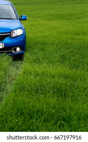 GOMEL, BELARUS - May 24, 2017: the blue car Renault Logan is parked on the green field