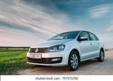 Gomel, Belarus - May 27, 2017: VW Volkswagen Polo Vento Sedan Car Parking In Field Near Country Road. Spring Or Summer Season. Wide Angle Shot