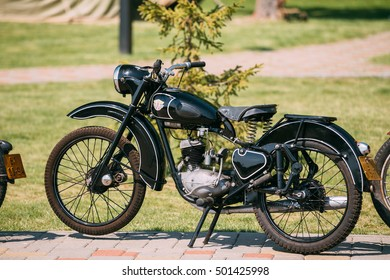 Gomel, Belarus - May 9, 2016: Minsk M1A Or M1nsk, The Old Rarity Soviet Two-Wheeled Black Motorcycle, The First Model Of Belarusian Manufacture, Displayed In Sunny Summer Park.