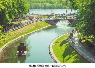 Gomel, Belarus - May 9, 2018: City park with a pond in the center on a summer day. Gomel