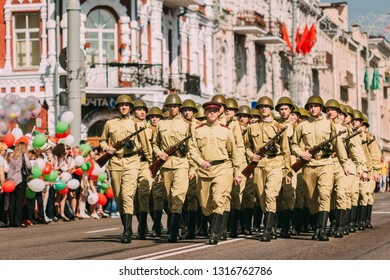 Gomel, Belarus - May 9, 2018: A company of soldiers of the red army of the USSR marching with the commander on Sovetskaya Street in the city of Gomel on parade