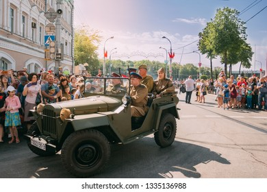 Gomel, Belarus - May 9, 2018: Red Army men in a military car passing through the intersection on Gomel Street on Victory Day, May 9