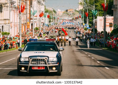Gomel, Belarus - May 9, 2018: Victory parade with orchestra on the Soviet street in Gomel on May 9 with a police car in the foreground
