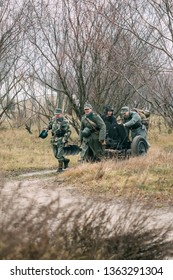 Gomel, Belarus - November 26, 2017: Reconstructors in the German form of the Wehrmacht pull the German gun Pak 36 to the position. Reconstruction of the liberation of the city of Gomel