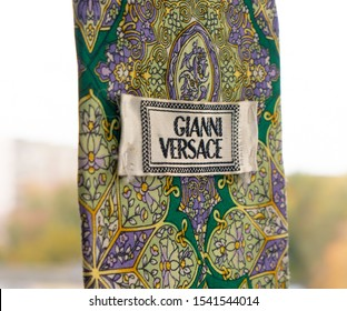 GOMEL, BELARUS - OCTOBER 25, 2019: Gianni Versace tie. Gianni Versace S.r.l. usually referred to simply as Versace, is an Italian luxury fashion company founded by Gianni Versace in 1978.