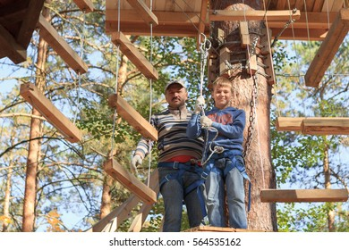 Gomel, Belarus - OCTOBER 5, 2014: Rope town for a family holiday in the countryside. Family competition to overcome aerial obstacles