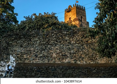 GONDAR, ETHIOPIA - JANUARY 17: An Ethiopian man sitting at the Fasilides Castle gate, founded by Emperor Fasilides and was designated a UNESCO World Heritage Site on January 18, 2018 in Gondar.