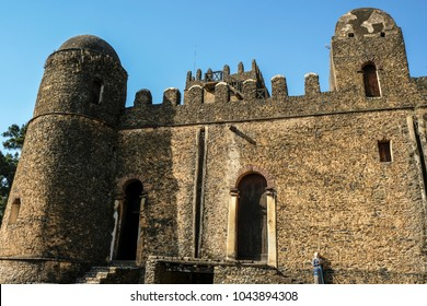 GONDAR, ETHIOPIA - JANUARY 18: An Ethiopian woman visit Fasilides Castle, founded by Emperor Fasilides and was designated a UNESCO World Heritage Site on January 18, 2018 in Gondar, Ethiopia.