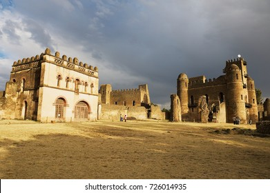 GONDAR, ETHIOPIA - JANUARY 22, 2010: Unidentified tourists visit medieval fortress in Gondar, Ethiopia. Gondar castle is a UNESCO World Heritage site.