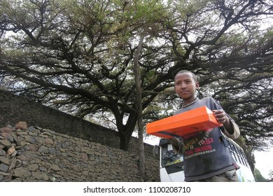 GONDAR, ETHIOPIA - MARCH 25 2012: Unidentified boy collects donations for the Ethiopian Orthodox Church during annual Great Fast in Gondar, Ethiopia. Gondar is the center of Orthodox Christianity.