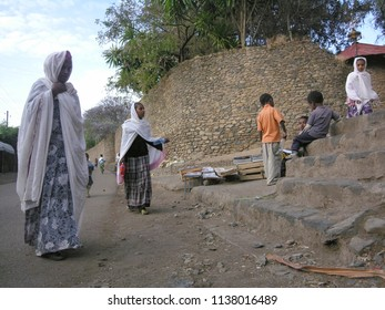 GONDAR, ETHIOPIA - MARCH 25 2012: Unidentified women walk to church by Fasilides Castle in Gondar, Ethiopia. Gondar is UNESCO World Heritage Site and center of Orthodox Christianity.