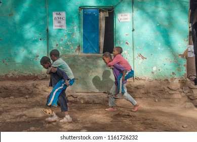 GONDAR, ETHIOPIA - MARCH 25 2012: Unidentified kids play at a street in Gondar, Ethiopia. Ethiopian children have to fend for themselves after school.
