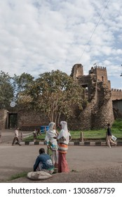 GONDAR, ETHIOPIA - MARCH 25 2012: Two unidentified women talk on ancient Fasilides Castle background in Gondar, Ethiopia. Gondar is UNESCO World Heritage Site and center of Orthodox Christianity.