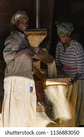 Gondar / Ethiopia - November 07 2005: Women milling corn.
