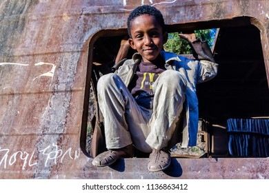 Gondar / Ethiopia - November 10 2005: Portrait of a boy playing in a disused tank.