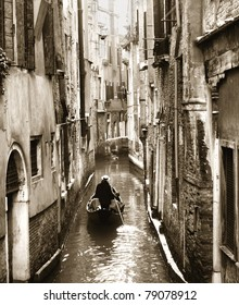 Gondola along a side canal, Venice, Italy