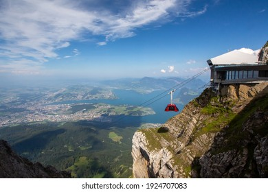A gondola begins descent from Mt. Pilatus near Lake Lucerne, Switzerland on a beautiful sunny summer day