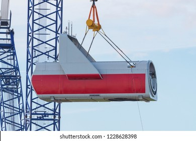 Gondola, also called nacelle, hangs on crane hook