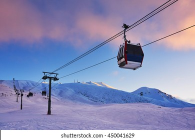 Gondola lift in the ski resort in the early morning at dawn