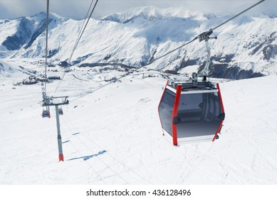 Gondola lift in the ski resort falls down the hill. Cableway in the mountains.
