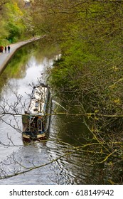A gondola makes its way up the channel from Little Venice to Camden in London, England.