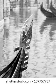 The gondola is in the nose of the traditional decoration in the form of a stylized caps Doge and symbols of the six areas of the city - Venice, Italy (black and white)
