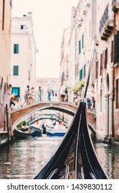 Gondola on along canal in Venice