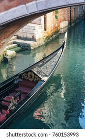 Gondola on a canal in Venice, Italy