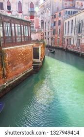 Gondola on lateral narrow Canal, Venice, Italy.