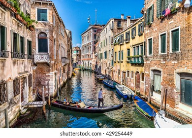 Gondola on a water canal in Venice, Italy surrounded by beautiful old buildings