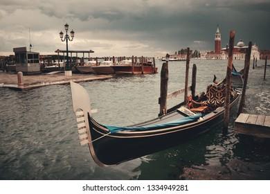Gondola park in water and San Giorgio Maggiore island in Venice, Italy.