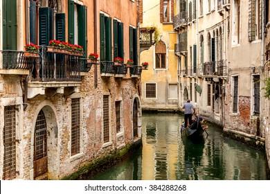 Gondola in picturesque Venice Canal - Venice, Italy