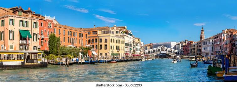 Gondola at the Rialto bridge in Venice, in a beautiful summer day in Italy