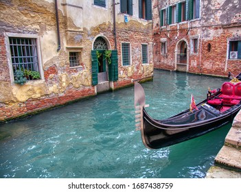 Gondola sailing through a canal in Venice, Italy.