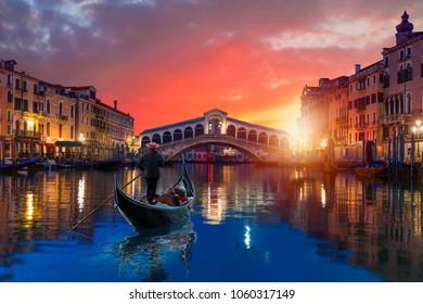A gondola service near Rialto Bridge at dusk - Venice, Italy