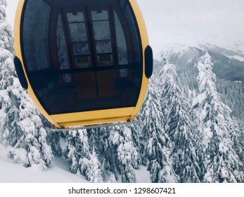 Gondola of ski lift in front of snow covered fir trees in skiing resort in Saalbach-Hinterglemm, Austria