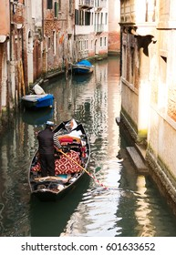 Gondola swims on a canal in Venice, Italy