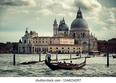 Gondola and Venice  Church Santa Maria della Salute in canal in Italy.