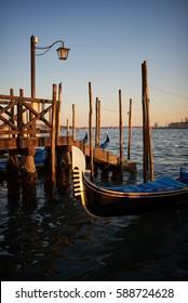 Gondola in VeniceVenice gondolas parked at San Marc, at sunset
