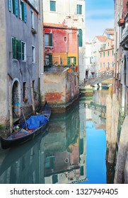 Gondolas In Canal with bridge Venice Italy