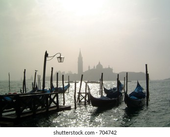 Gondolas in the early morning October haze from San Marco